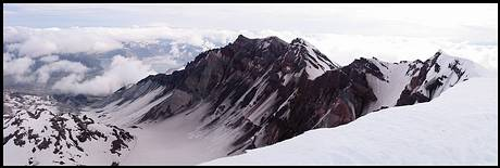 Climb of Mount St. Helens: crater with lava dome, Mount Rainier in the background
