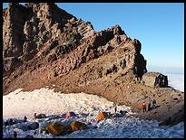 Climb of Mount Rainier: Camp Schurman with Steamboat Prow, rangers hut, and tent city
