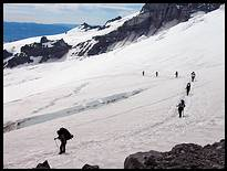 Climb of Mount Rainier: guided party arriving at Camp Schurman