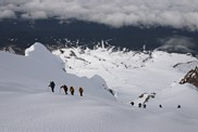Mount Hood climb: climbers approaching the summmit, the ski lifts of Timberline ski area is visible in the background