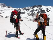 Mount Rainier climb: Jeff and Kira roping up to cross the Nisqually