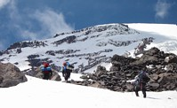 Mount Rainier climb: climbers on their way to Camp Hazard