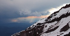 Mount Rainier climb: sun set with distant thunderstorms