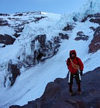 Mount Rainier climb: Gary with the chute that we had to traverse left to get into another chute thats behind the ice cliffs and that we ascended