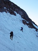 Mount Rainier climb: crossing the dangerous chute below the ice cliffs; waiting for Gary to place pro