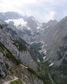 Alpspitze via KG-Weg: descend into the Hoellental in a thunderstorm; Knappenhaeuser, Hoellentalferner, and Zugspitze in the background