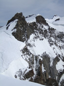 Ludwigshoehe, Parrotspitze, etc: Signalkuppe seen from the south, climbers climbing over a cornice