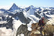 Zinalrothorn: Wilfried hig hup on Zinalrothorn with Matterhorn, Wellenkuppe, Obergabelhorn in the background
