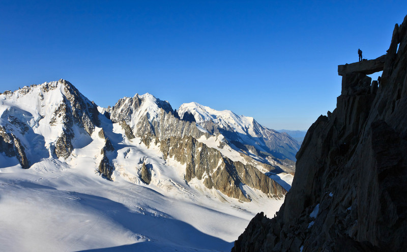 "Climber on the ""couloir de la table"" route on Aiguille du Tour (3544 m) in the Mont Blanc massif with Aiguille du Chardonnet, Aiguille Verte, and Mont Blanc (from left to right) (keywords: aiguille verte, aiguille du chardonnet, aiguille du midi, aiguille du tour, alpen, alps, berg, berge, bergsteiger, dome de gouter, france, frankreich, kletterer, leute, mont blanc, mont blanc du tacul, mont blanc massif, person, wächte, wächten, alpinist, climber, cornice, crevasse, glacier, mountain, mountaineer, mountains, people, ridge)"